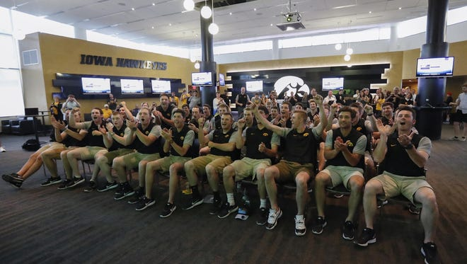 The Hawkeyes celebrate their bracket revealing at Monday's watch party at the Feller Club Room insider Carver-Hawkeye Arena.