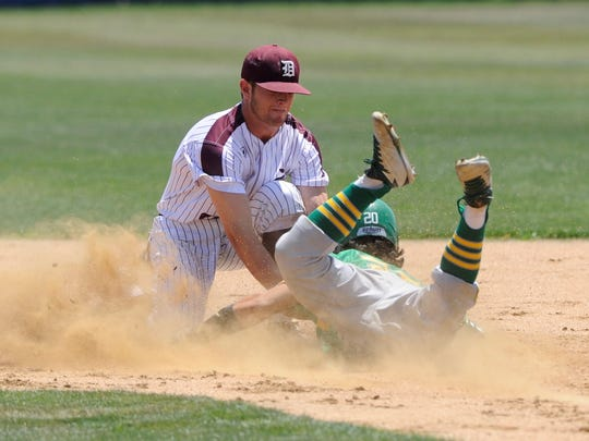 De Leon shortstop Kevin Yeager (8) puts the tag down on New Deal's Brandon Coronado on an attempted steal during the Bearcats' 11-1, five-inning win against New Deal in Game 1 of the Region I-2A semifinal series at Stamford on Friday, May 25, 2018.