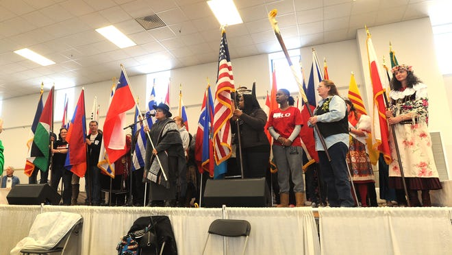 Lucia Dowling of Taycheedah, a Chilean immigrant, announces the flag of Chile at Celebrate CommUNITY. The multi-cultural event on Saturday, Feb. 28 drew hundreds to the Fond du Lac County Fairgrounds to enjoy ethnics foods, music and share traditions.