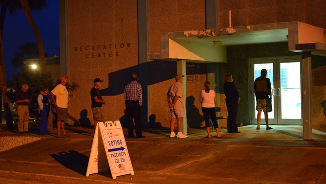 People lined up in the dark before the polls opened in Cocoa Beach at Ramp Road Recreation Center to vote in precincts 222 ands 236 in Florida's primary election.