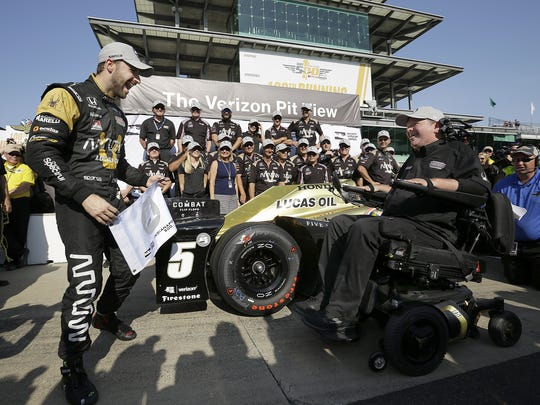 IndyCar driver James Hinchcliffe (5) celebrates with team owner Sam Schmidt,right, winning the pole position100th running of the Indianapolis 500 on Armed Forces Pole Day Sunday, May 22, 2016, afternoon at the Indianapolis Motor Speedway.