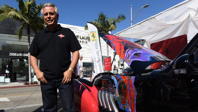 Al Dimora poses with his $1.2 million Vicci 6.2 at the Rodeo Drive Concours d'Elegance.