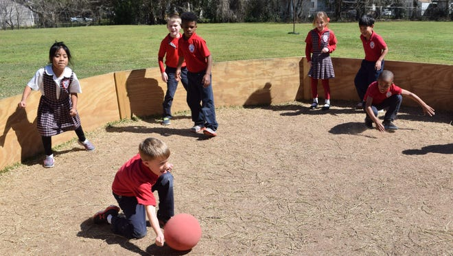 """St. Frances Cabrini school first-graders play a game called """"Gaga."""" Students have to hit the ball with their hands to tag out the other students. The ball has to hit below the waist to get another person out. If it hits above the waist the student who hit the ball is out. The game will be part of a children's obstacle course being added to the school's Xtreme Obstacles event April 9."""