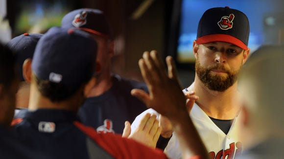 Cleveland Indians starting pitcher Corey Kluber (28) is congratulated after being taken out of the game during the eighth inning against the Cincinnati Reds at Progressive Field.