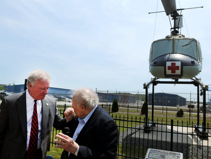 Ocean City Mayor Rick Meehan, left, speak with Ocean City Aviation Association President Tom Oneto during a dedication ceremony of the new Huey Veteran's Memorial Monday afternoon at the Ocean City Airport.
