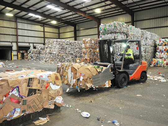 Waste Management trucks in recyclable materials to this facility in the Cocoa area, where the various plastic, paper, glass and other materials are sorted. Palm Bay resident Christine Kane wants to county to implement mandatory recycling, instead of the current system of voluntary recycling.
