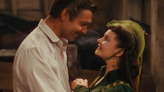 "This photo provided by Warner Bros. Home Entertainment shows Clark Gable, left, as Rhett Butler, and Vivien Leigh as Scarlett O'Hara in a scene from the film, ""Gone With the Wind."" The film's 75th anniversary will be celebrated over the next week, with special screenings and Warner Bros. Home Entertainment's release of a lavish new limited-edition box set."