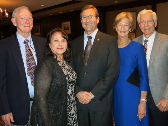 Dr. Don and Kathy Smith, Dan Snyder, Carolyn and Dr. Dean Griffin at neurosurgery party.