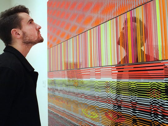 Ryan Pattison looks at the artwork of Beverly Fishman at the Eli and Edythe Broad Museum.