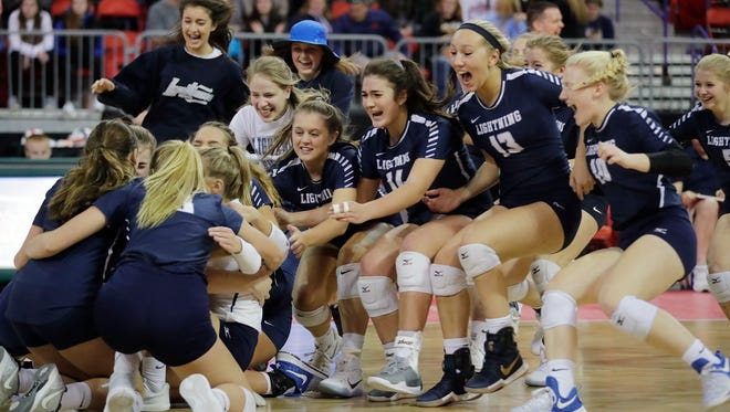 Lake Country Lutheran players rush the court after defeating Regis in the Division 3 championship match at the WIAA State Girls Volleyball Tournament at the Resch Center on Saturday, November 4, 2017 in Ashwaubenon, Wis. Lake Country won the championship, 3-1.Adam Wesley/USA TODAY NETWORK-Wisconsin