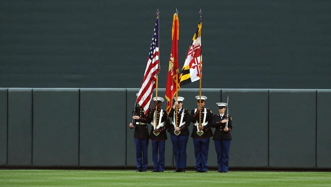 Members from the Pocomoke High School JROTC program present the colors at Oriole Park at Camden Yards prior to the first pitch of the Baltimore Orioles game on Thursday, July 2.