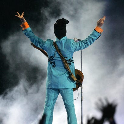 Prince performs during the halftime show at Super Bowl XLI on Feb. 4, 2007, in Miami.