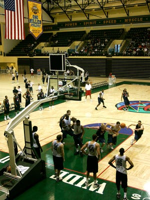 FILE - In this June 6, 2006, file photo, college players scrimmage during an NBA pre-draft basketball camp at the Disney Wide World of Sports complex in Kissimmee, Fla. Most of the 22 remaining NBA teams were taking the court for the first mandatory workouts in nearly four months Wednesday, July 1, 2020, as the league continued prepping for the restart of the season at the Disney campus near Orlando, Florida. Workouts are still individual in nature, but are no longer voluntary.
