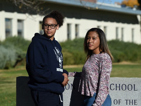 Siblings Taylissa Marriott, left, and her sister Jayla Tolliver stand outside Yeringtion High School.