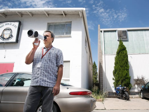 Ben Siller, an environmental protection investigator in Denver's Department of Environmental Health, uses a Nasal Ranger to discern odorous air while investigating odor complaints around the city.