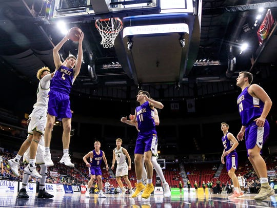 Dylan Jones of Waukee pulls down a rebound during the