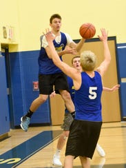 Alex Yeager drives to the basket during practice in