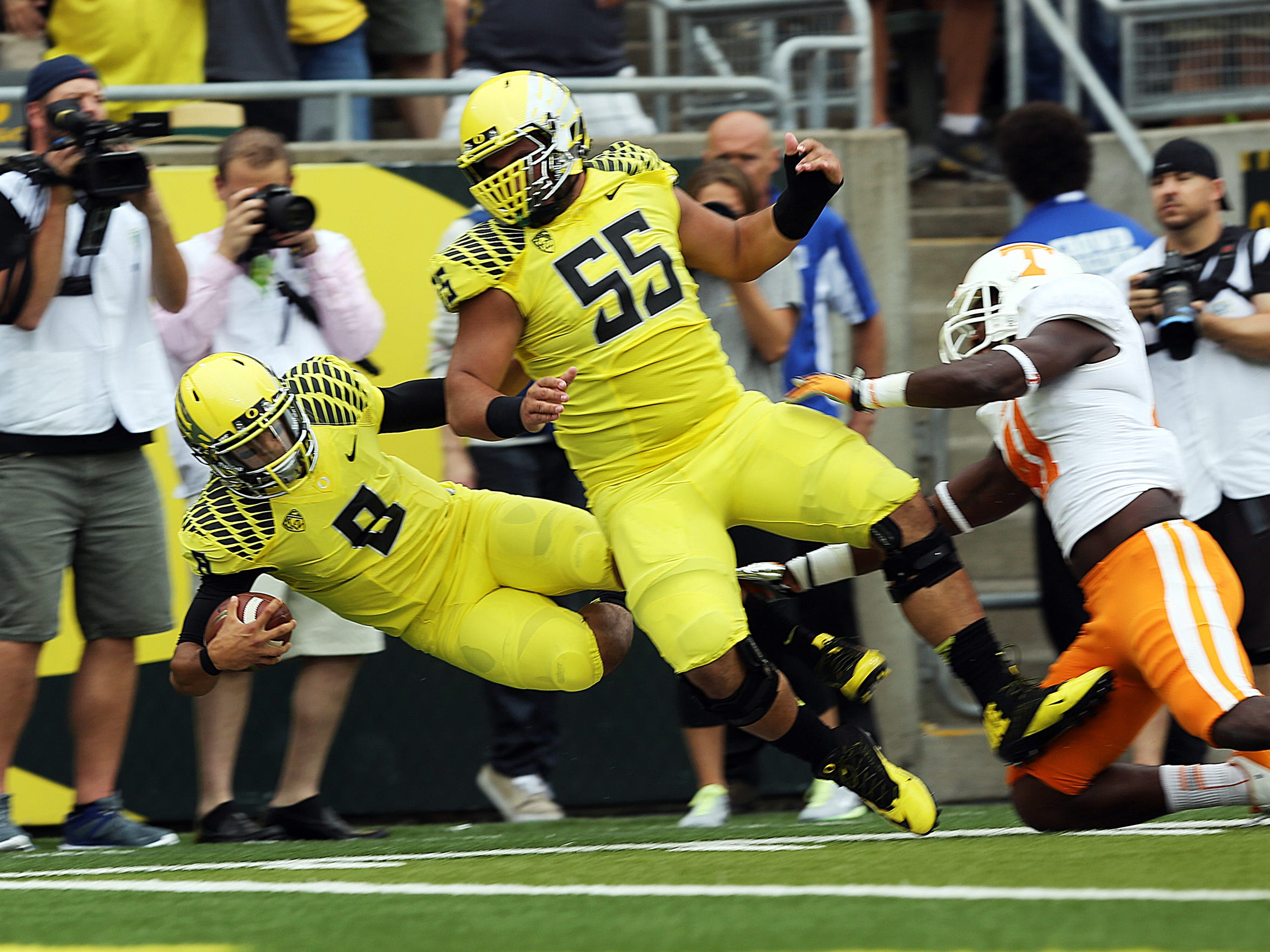 Marcus Mariota and the Oregon Ducks defeat Tennessee 59-14 in a college football game at Autzen Stadium in Eugene in 2013.
