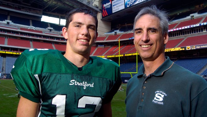 The NCAA has hired Oliver Luck (right), shown here with his son, Andrew, when the current Colts' quarterback was in high school.