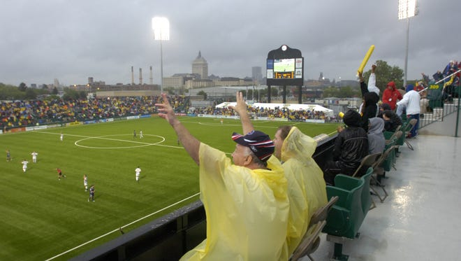 Mike Halm, left, of Webster and Gary Mallaber, of Greece, cheer early in the game during the Rhinos game with Virginia Beach at PAETEC Park Saturday night, June 3 2006. It was the first game played in the new stadium.