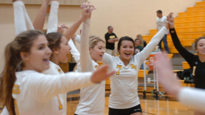 The Bishop Verot girls volleyball team celebrates winning the District 4A-10 championship game on Thursday against LaBelle