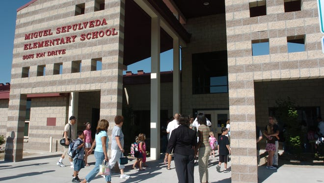 Students and parents enter the doors of Sepulveda Elementary School.