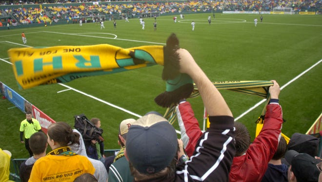 Fans wave Rhinos scarves during the inaugural match at Rochester's soccer stadium on June 3, 2006.