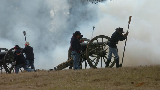 A cannon is fired during a Civil War battle re-enactment at Forts Randolph & Buhlow State Historic Site in Pineville. Battle re-enactments are set for 1 p.m. Saturday and Sunday at the forts as part of Blue and Gray on the Red history events, which begin Thursday and run through Sunday.
