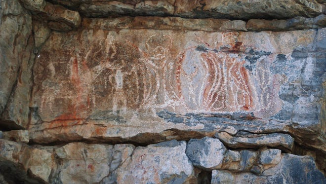 Apache rock art containing both animal and human mythical horned figures.  WSMR has won a Department of Defense award for management of its cultural resources.
