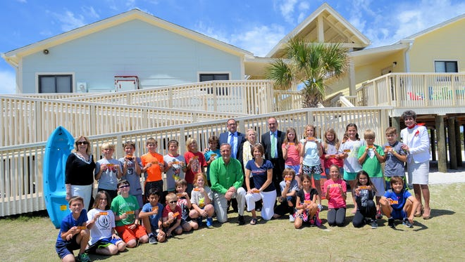 Pensacola Beach Elementary School fourth-grade students pose with special visitors, standing from left, Dr. Diane Buck, president, Intercambios Culturales of Marbella, Gregorio Campos, Mayor of Iznate, Spain and President of the Axarquía, Maria Davis, Honorary Vice Consul to Spain, Antonio Campos, Mayor of Macharaviaya, Spain, and Nan Harper, President, Pensacola Sister Cities International.  Kneeling are Pensacola Beach Elementary School Principal Jeff Castleberry and fourth-grade teacher Erin Olson.