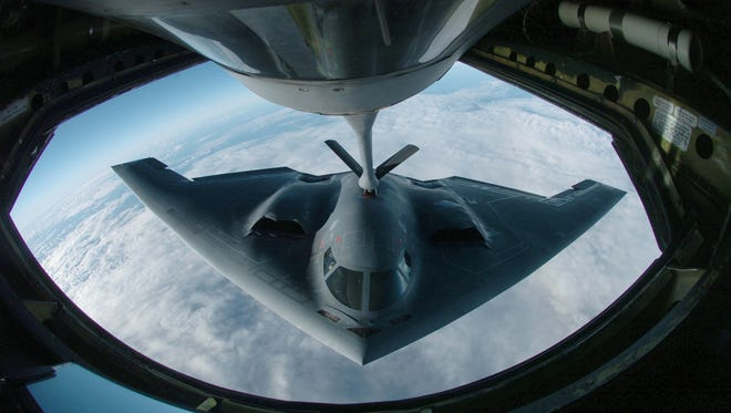 A B-2 Spirit bomber refuels from a KC-135 Stratotanker here during a deployment to Andersen Air Force Base, Guam, in this 2007 file photo. (U.S. Air Force photo by Master Sgt. Val Gempis)   Getting gas: A B-2 Spirit bomber refuels from a KC-135 Stratotanker during a deployment to Andersen Air Force Base. The bomber deployed as part of a rotation to provide a continuous bomber presence in the Asia-Pacific region. The Spirit is from the 509th Bomber Wing at Whiteman AFB, Mo. The Stratotanker is assigned to the Illinois Air National Guard's 126th Air Refueling Wing at Scott AFB.    ***NO RESALE***