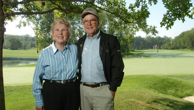 Alice and Pete Dye stand under the trees at the back side of the 18th hole at The Bridgewater Club in Westfield in 2005.  The Dyes designed the course.
