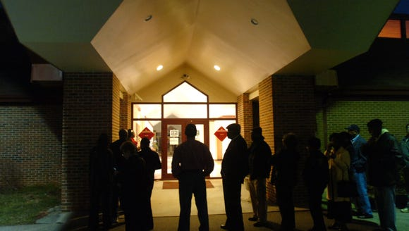 In this 2008 file photo, voters line up in the pre-dawn