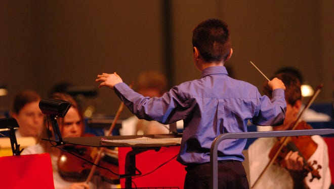 """When he was in third grade, Paul Merkamp served as a guest conductor for a piece performed in the """"Colors of the Symphony"""" children's concert. On Sunday, he's competing in the symphony's Young Artist Competition for middle school and high school students."""