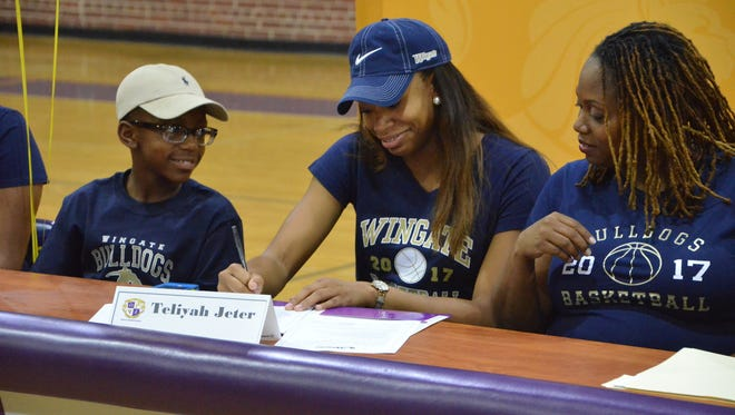 Legacy Charter School senior Teliyah Jeter signs to continue her basketball career at Wingate University.