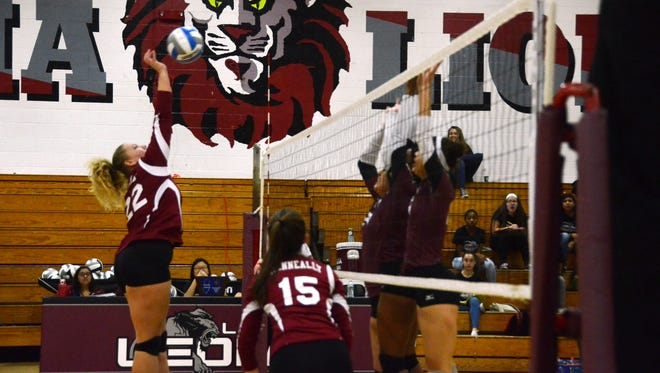 Carly Waterman and the Verona volleyball team defends the net against Bogota during a state tournament game against Leonia Thursday, Nov. 10.