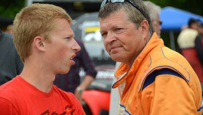 Braison Bennett and his father, Lowell, chat at the 2014 Slinger Nationals.
