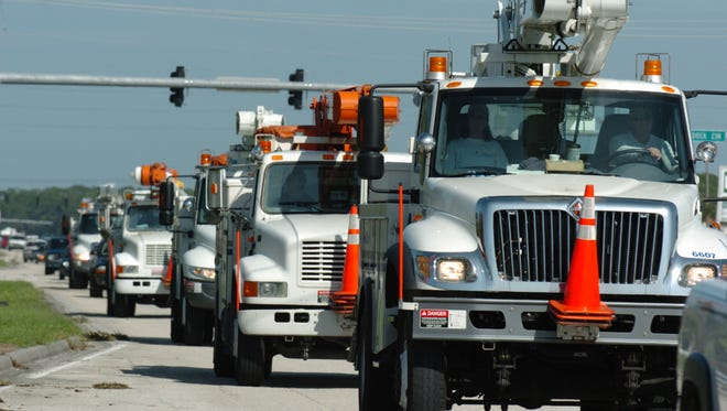 A convoy of FPL trucks head south in August 2004 to address power outages caused by Hurricane Charley.