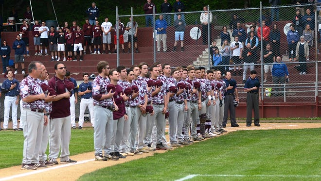 The Nutley baseball team stands for the national anthem prior to the greater newark tournament final at Verona High School's Doc Goeltz Field. Nutley baseball 2016