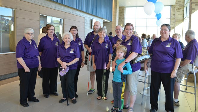 Members of the Livonia Civic Chorus attended the grand opening.