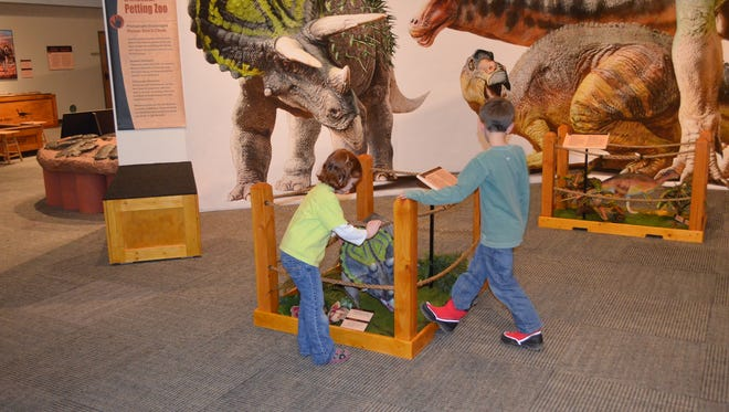 Petting the baby dinosaur helps kids learn that dinosaurs were once living, breathing animals.