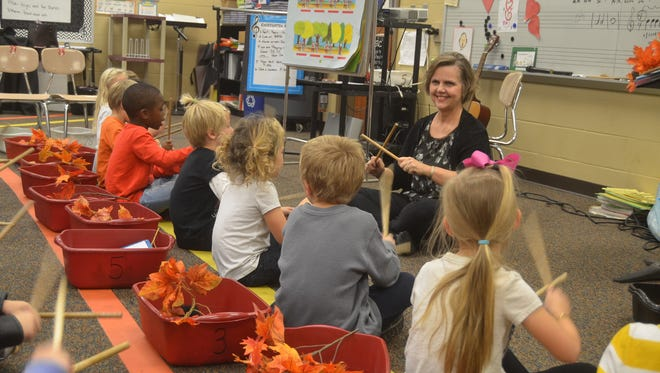 Station Camp Elementary School music teacher Pam Andrews leads her kindergarten class in song.