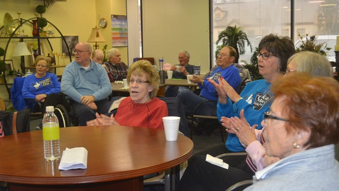 Dementia and Alzheimer's clients at The Veranda clap while singing songs together.