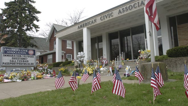 American flags stand in the lawn in front of the American Civic Association on Tuesday, April 14, 2009.