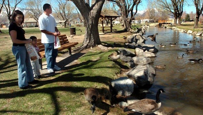 From 2004: A family feeds geese at Gardnerville's Lampe Park in March 2004. The park is near Lampe Ranch, which was placed on the National Register of Historic Places in April 2018.