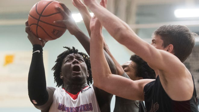 Austin-East's Chris Hunter takes a shot during a high school basketball game between Austin-East and Bearden at Austin-East Tuesday, Feb. 13, 2018.