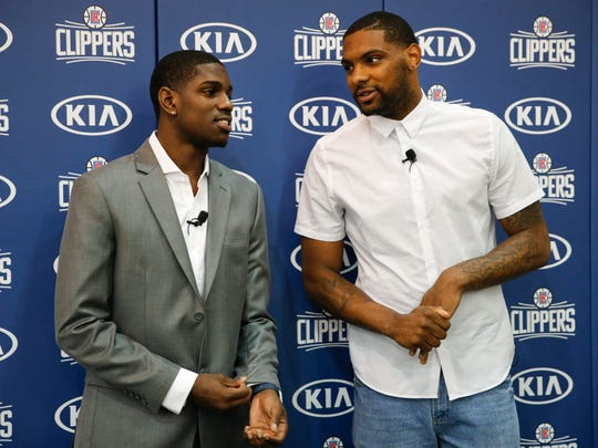 Los Angeles Clippers guards Jawun Evans, left, and Sindarius Thornwell chat after an NBA basketball news conference Tuesday, July 18, 2017, in Los Angeles. (AP Photo/Jae C. Hong)