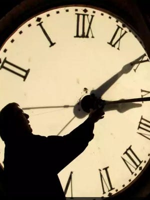 Clock being set for Daylight Saving Time.