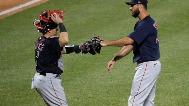 Boston Red Sox relief pitcher Brandon Workman, right, and catcher Christian Vazquez celebrate the team's 4-2 win over the New York Mets in a baseball game Thursday, July 30, 2020, in New York.