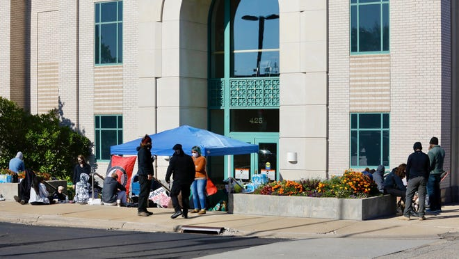 Protesters'  supplies and tables block an entrance to Rockford City Hall on Sunday. Six people were arrested for blocking the entrance on Monday.